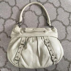 Very stylish cream colored handbag